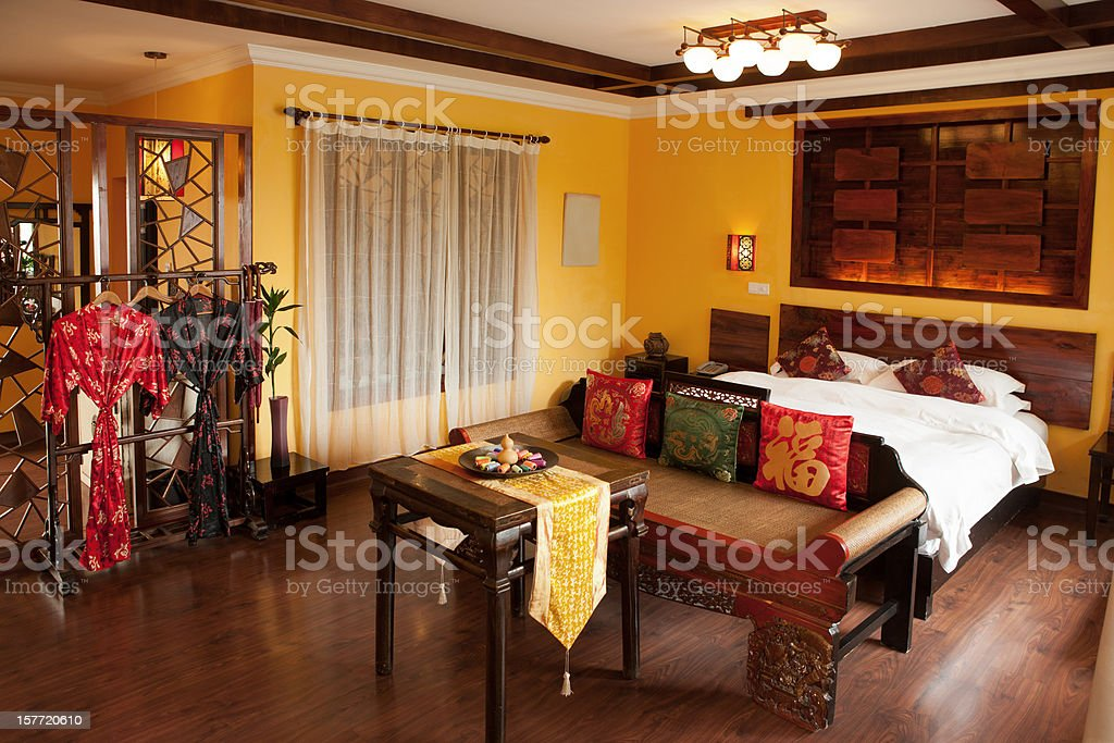 Asian style bedroom (HOTEL) royalty-free stock photo