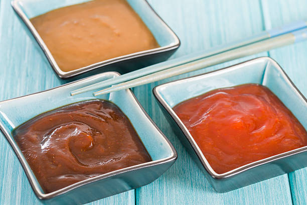 Asian Style Dips Hoisin sauce, soybean paste and chili sauce on a blue background. sriracha tiger zoo stock pictures, royalty-free photos & images