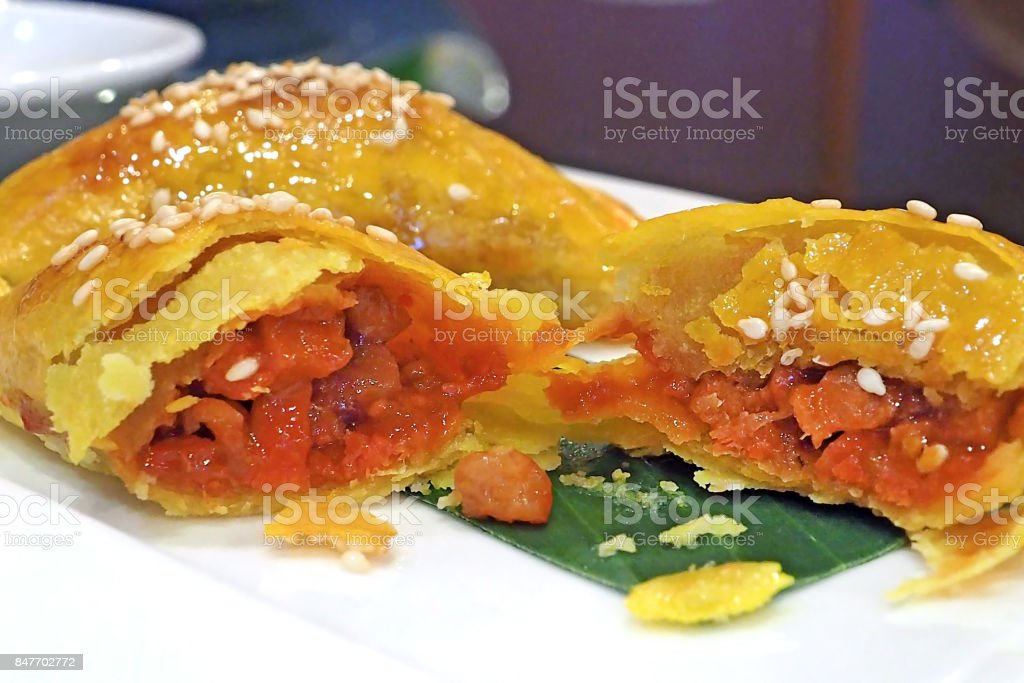 asian style food - Deep fried roasted pork puff served on white dish stock photo