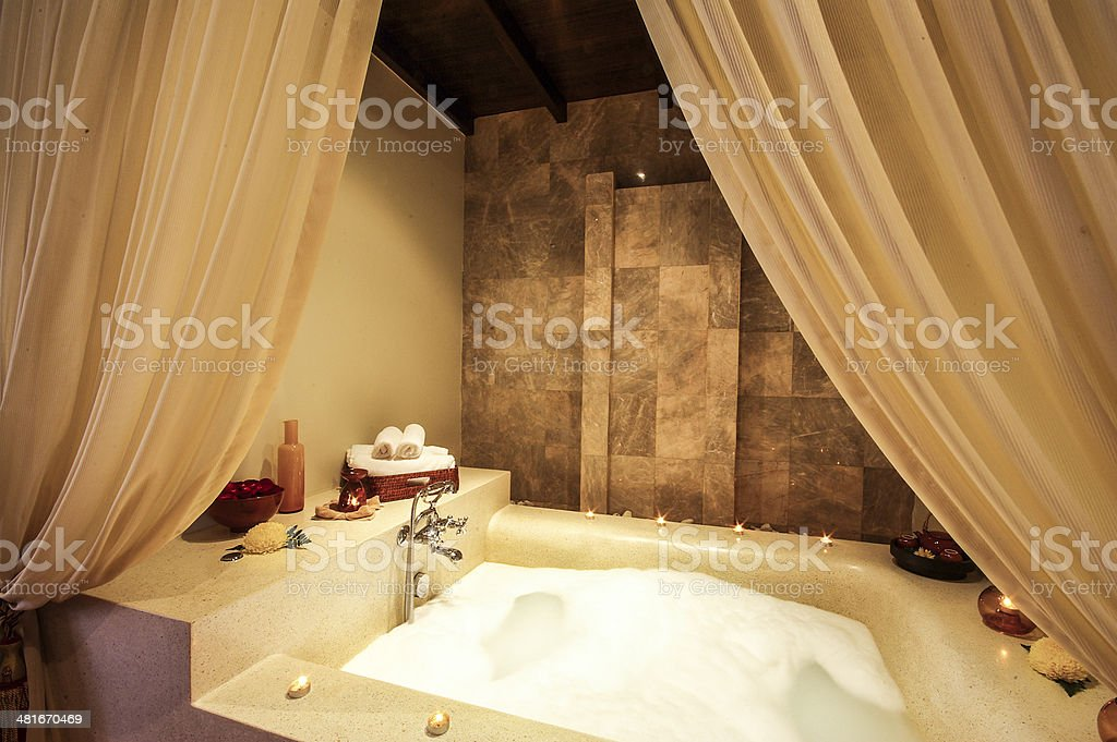 Asian style jacuzzi in spa room stock photo