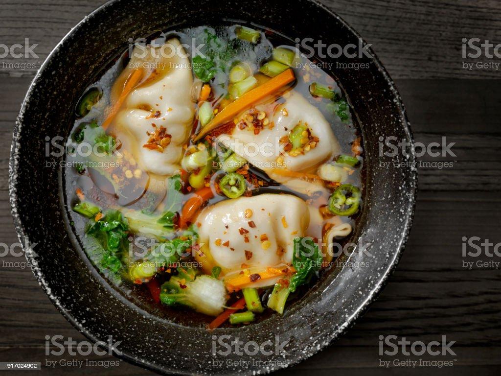 Asian Style Pork Dumpling Soup stock photo