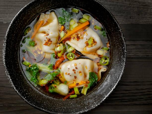 asian style pork dumpling soup - dumplings stock photos and pictures