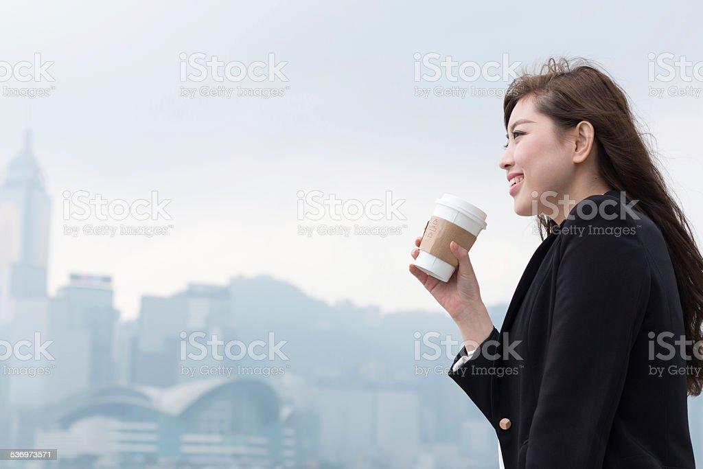 asian successful businesswoman drinking coffee portrait in Hongkong stock photo