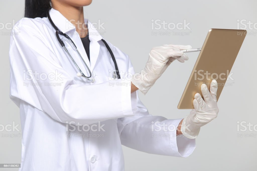 Asian Tan Skin Woman Doctor glasses in White Shirt suit with stethoscope on neck zbiór zdjęć royalty-free