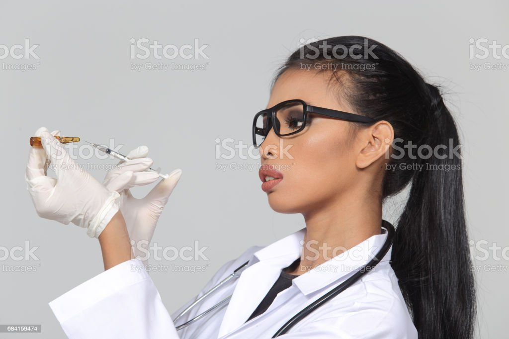 Asian Tan Skin Woman Doctor glasses in White Shirt suit with stethoscope on neck royalty-free stock photo