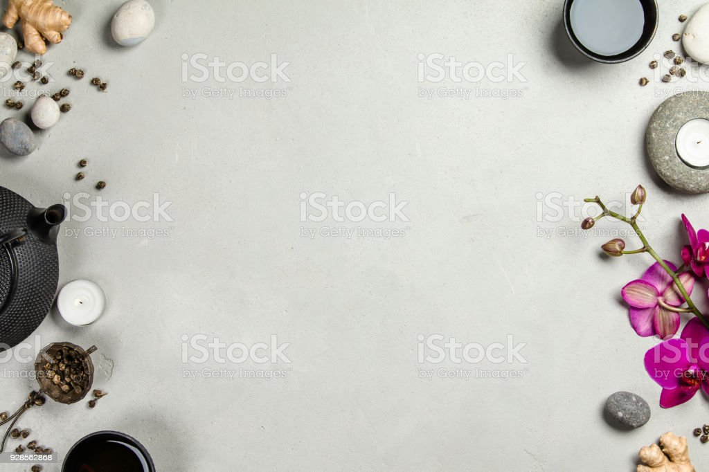 Asian tea set and spa stones on concrete background stock photo