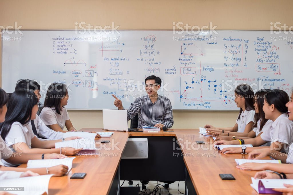 Asian teacher Giving Lesson to group of College Students in the classroom, University education concept stock photo
