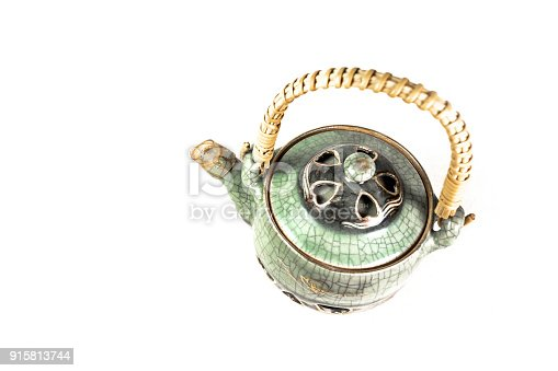 Asian Teapot on White Background from directly above. Chinese porcelain. Space for copy.