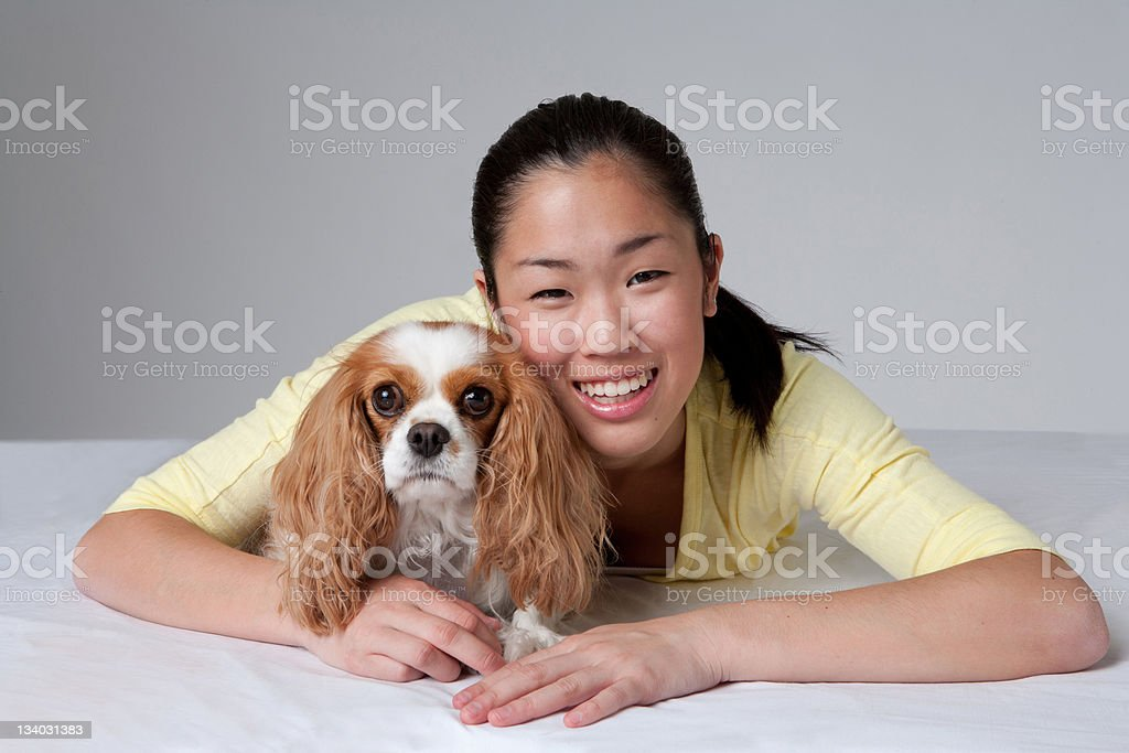 Asian Teen and Her Dog royalty-free stock photo