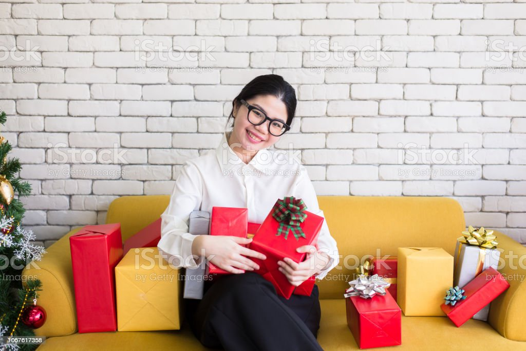 Asian Teen Girl Holding Christmas Gift Boxhappy And Smiling ...