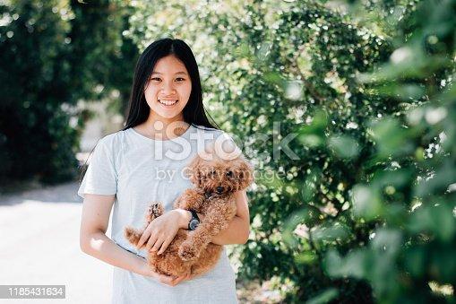 Teenage with Dog Outdoors