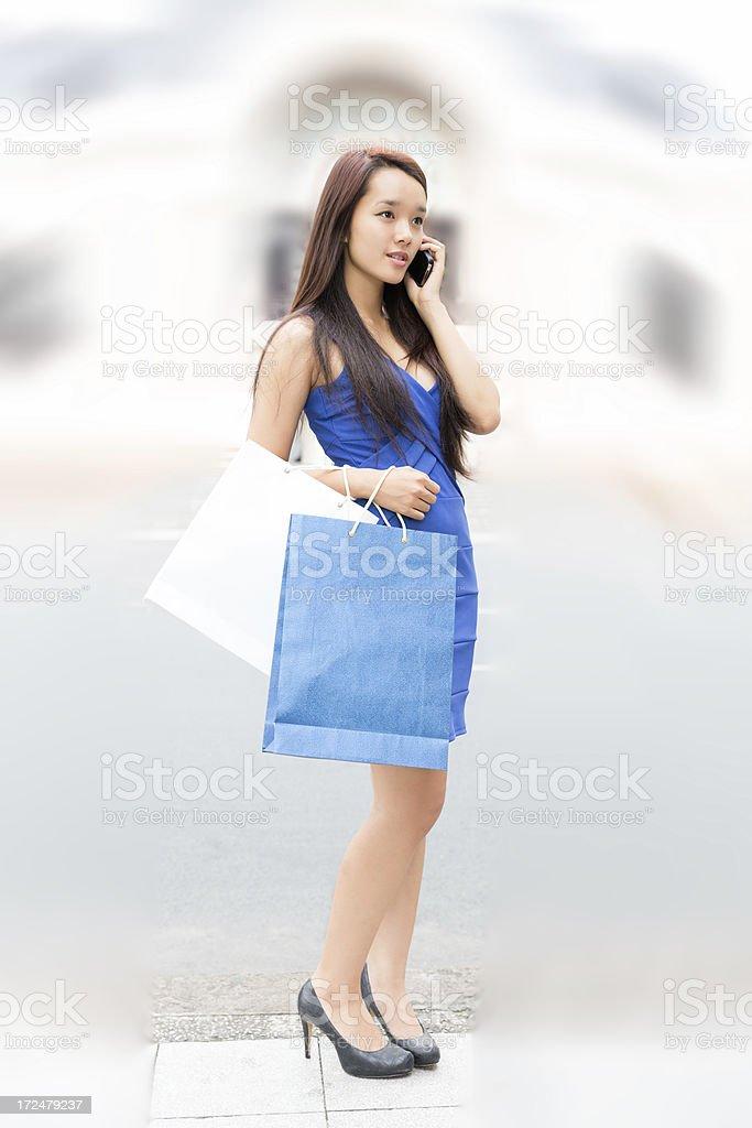Asian Teenage Girl Talking On Cellphone royalty-free stock photo