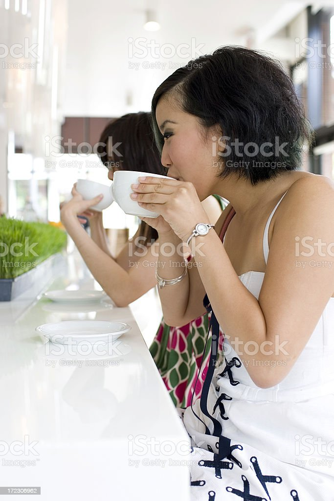 Asian Teenage Girls Sipping Coffee at Downtown Cafe, Copy Space royalty-free stock photo