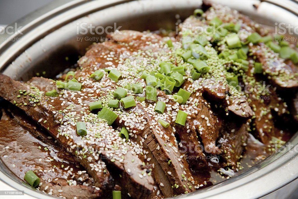 Asian Teriyaki Beef Dish with Sauce and Green Onions stock photo