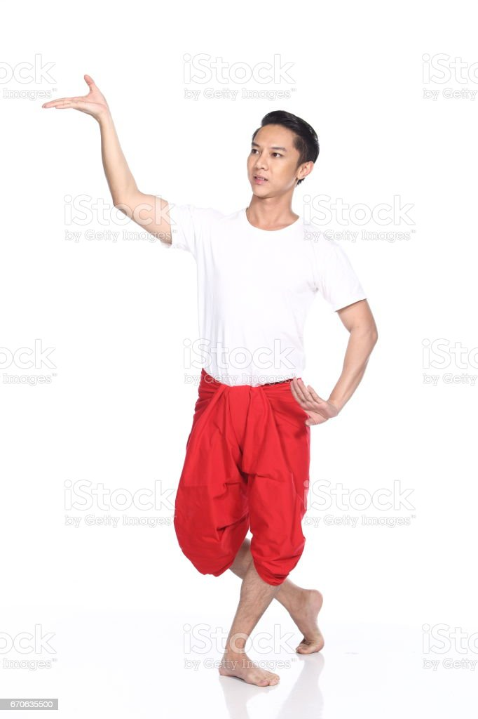 Asian Thai Tan Skin Man Classical Dance in white shirt red loincloth stock photo