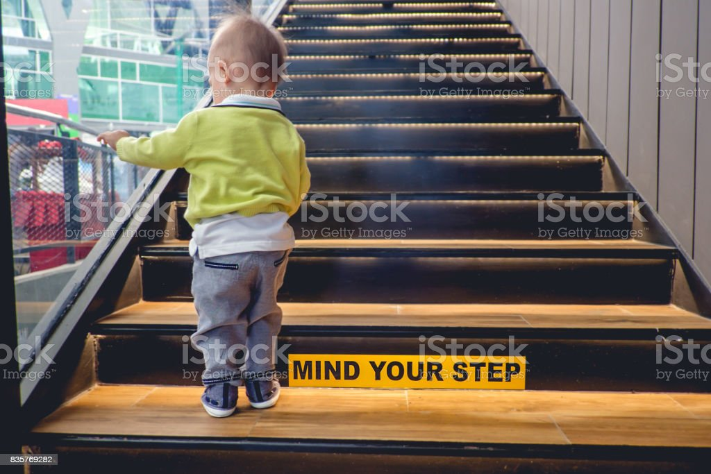 Merveilleux Asian Toddler Boy Climbs Up The Wooden Stairs Stock Photo | IStock