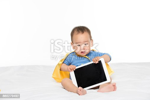 istock asian toddler boy with tablet 885279492
