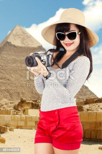 istock Asian tourist at pyramid 491445325