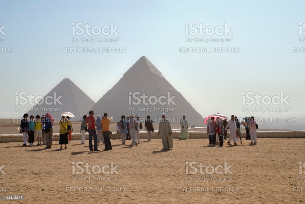 Asian tourists at the Pyramids in Giza, Cairo, Egypt royalty-free stock photo