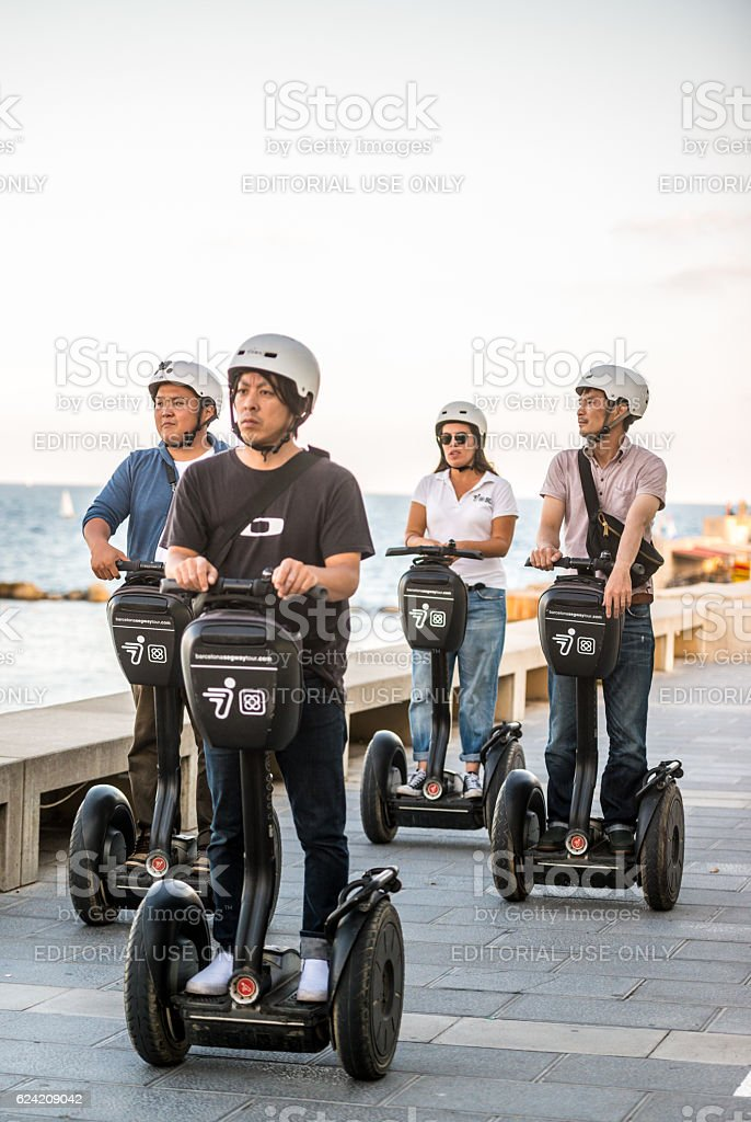 Asian tourists on Segways in Barcelona, Spain stock photo