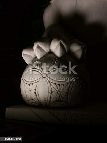 Asian traditional Chinese stone lion feet closeup
