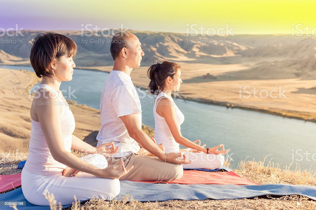 Asian trainer conducts classes of group yoga outdoor stock photo