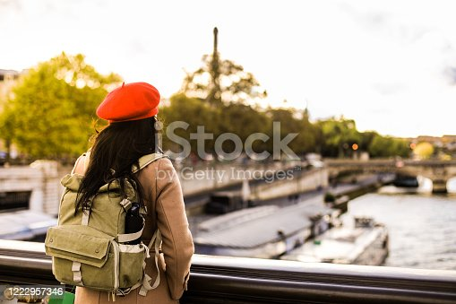 young asian woman traveling alone in Paris