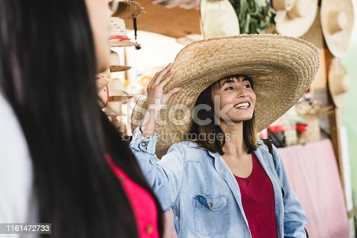 Asian traveler wearing a Mexican hat