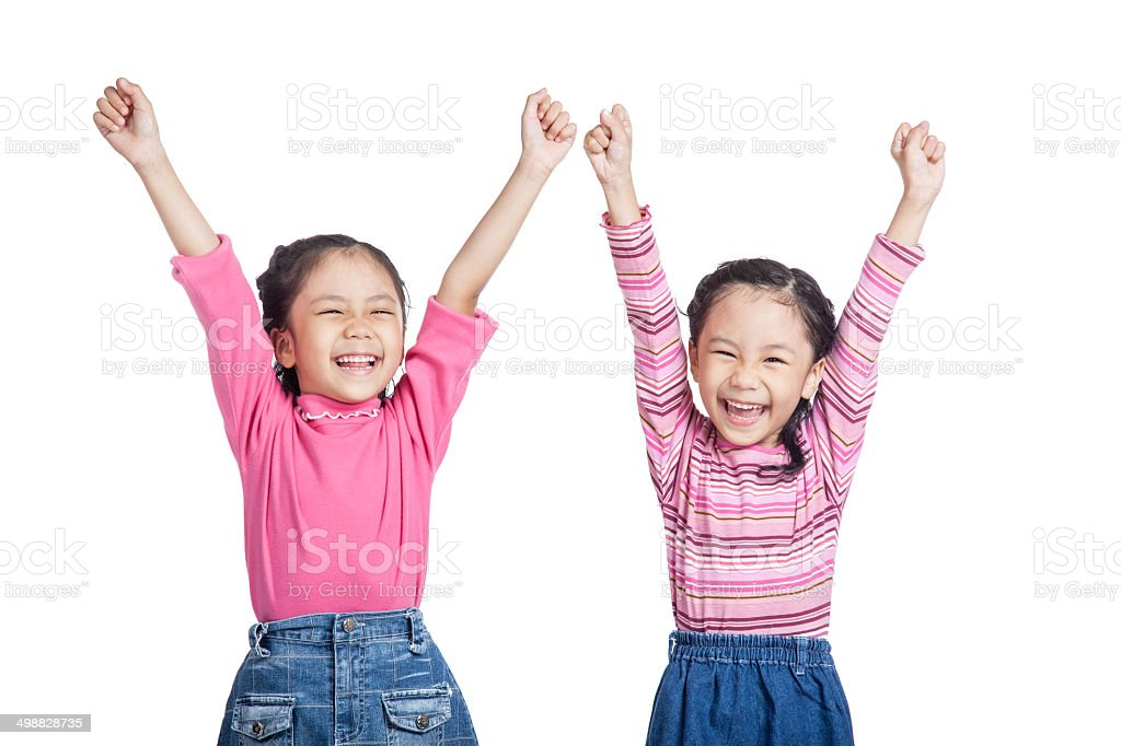 Asian twin sisters very happy  rise hands up stock photo