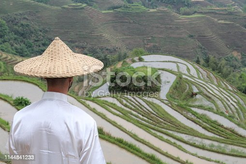 istock Asian villager in Asian rice terraces 1144841233