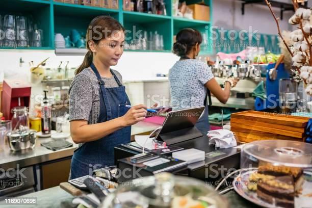 Asian waitress checking bills orders and cash register with tablet picture id1169070698?b=1&k=6&m=1169070698&s=612x612&h=  lwsi skcxv1u8nsm67vzzvc7f45vwxqssefsnmnv8=