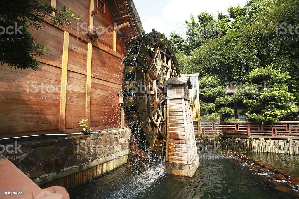 Asian water  turbine with garden. stock photo