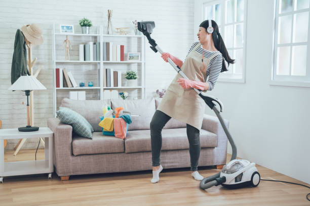 asian wife cleaning home playing vacuum cleaner. - stay at home parent stock pictures, royalty-free photos & images
