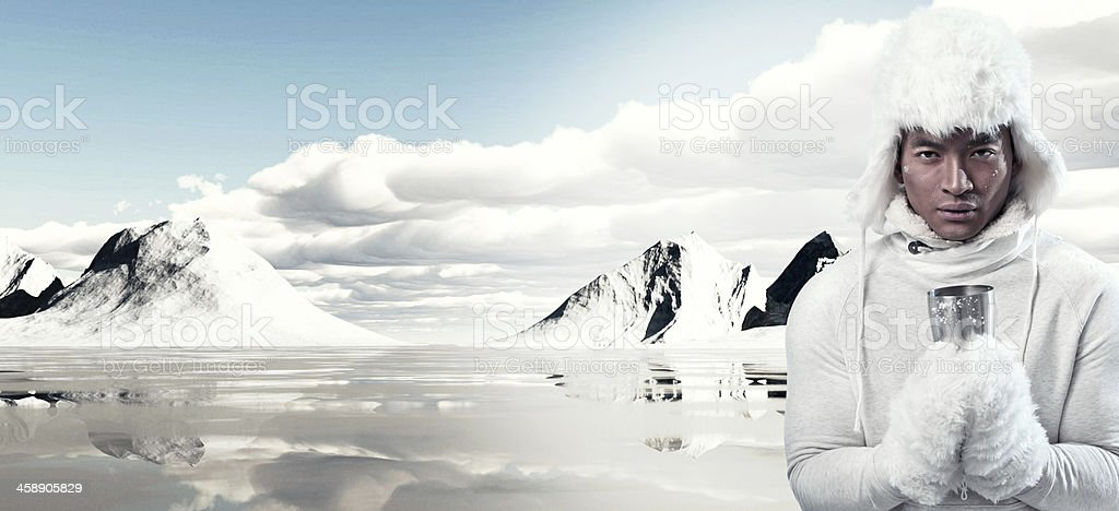 Asian winter fashion man in snow mountain landscape. stock photo