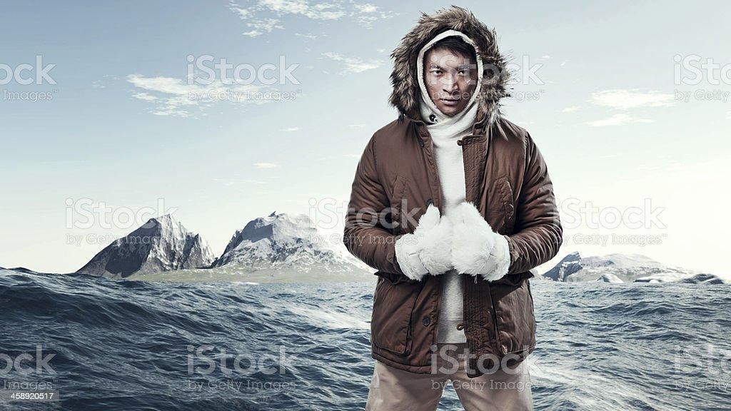 Asian winter sport fashion man in arctic mountain landscape. stock photo