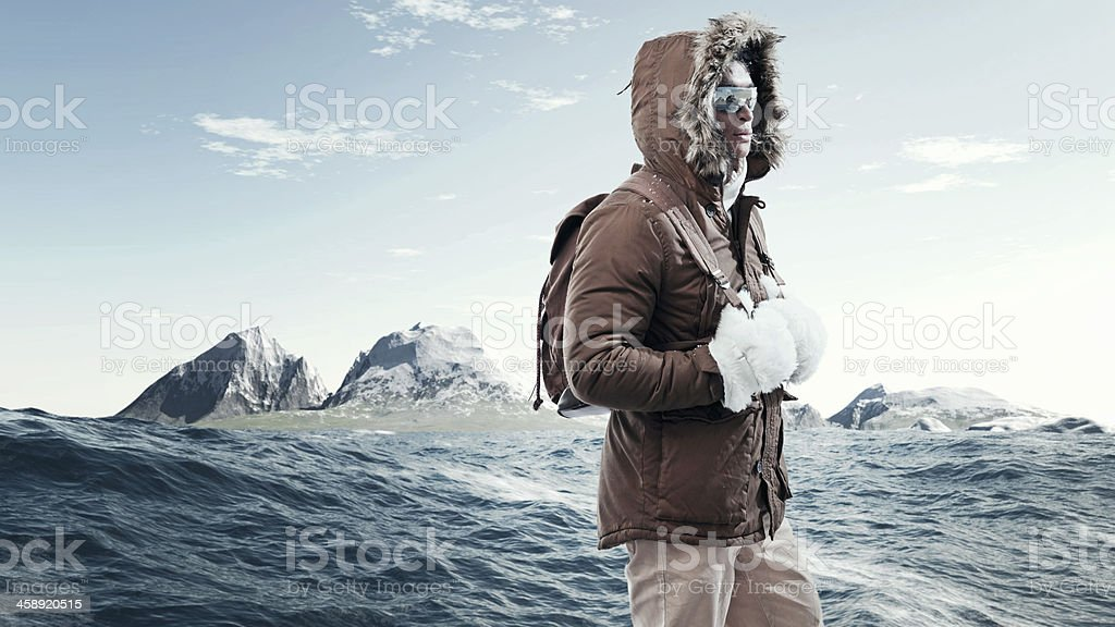Asian winter sport fashion man with sunglasses and backpack. stock photo