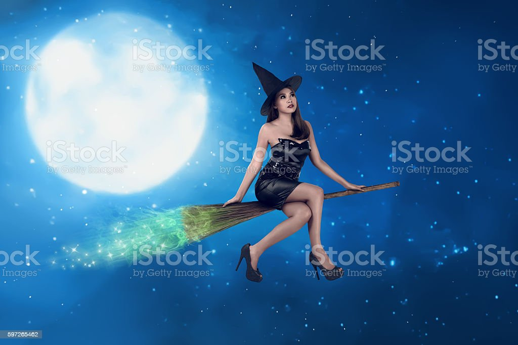 Asian witch woman ride the broom on the sky stock photo