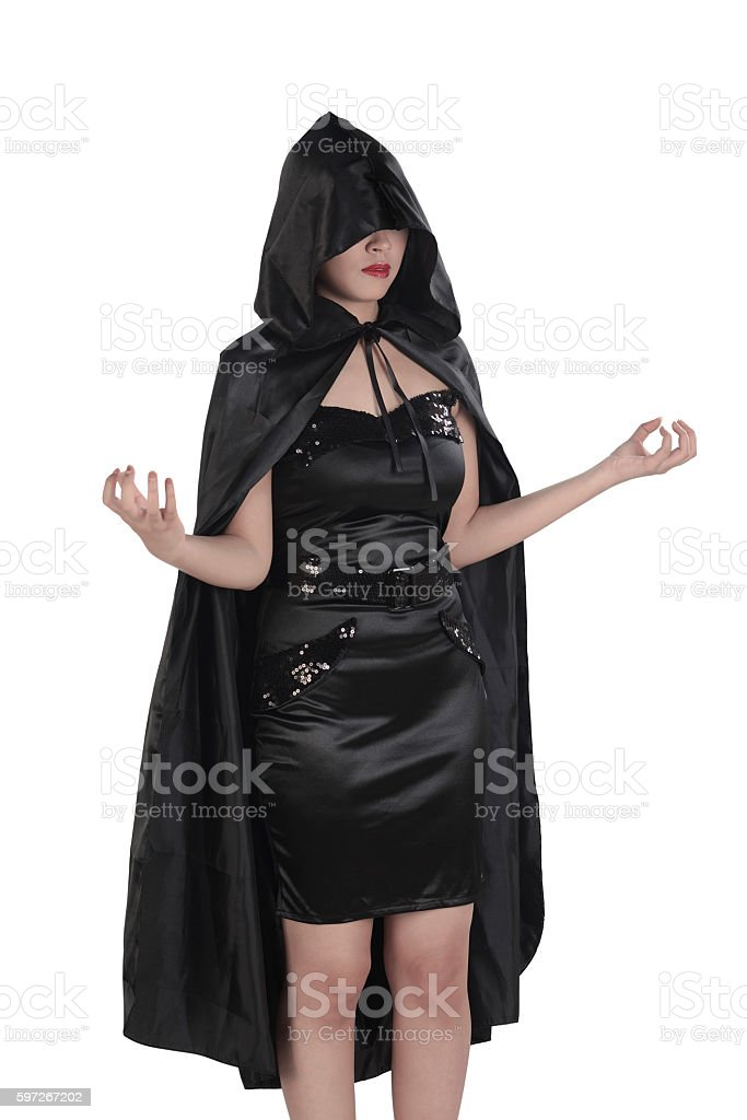 Asian witch woman with hand gestures and wearing black costume Lizenzfreies stock-foto
