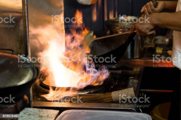 Asian Wok Cooking With Flames In An Open Style Street Food Kitchen Stock Photo Download Image Now Istock
