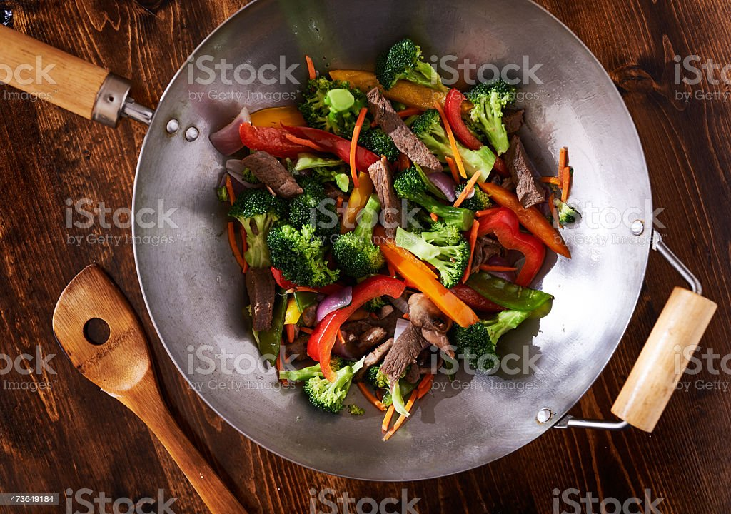 asian wok stir fry shot from over head stock photo