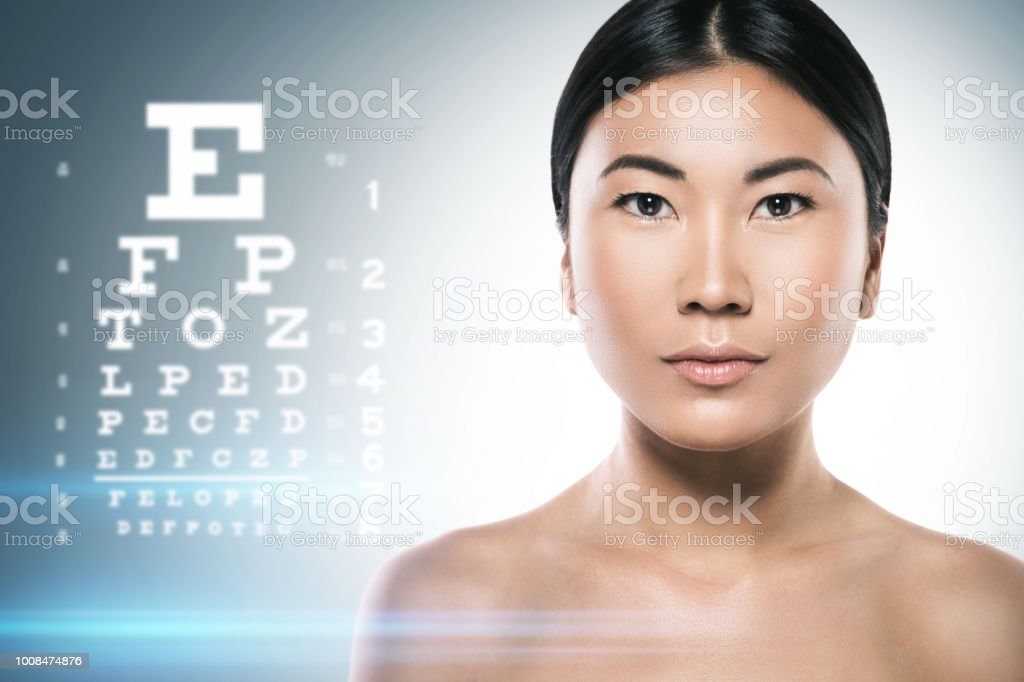 Asian Woman And Eye Chart For Sight Test Stock Photo & More