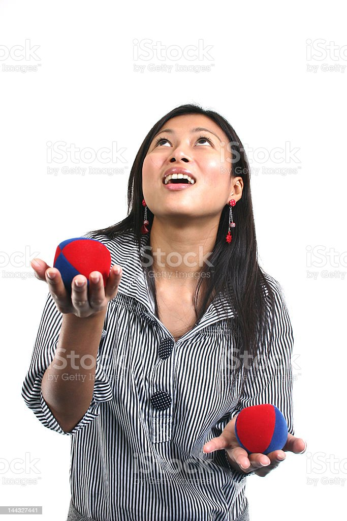 Asian woman and juggling balls royalty-free stock photo