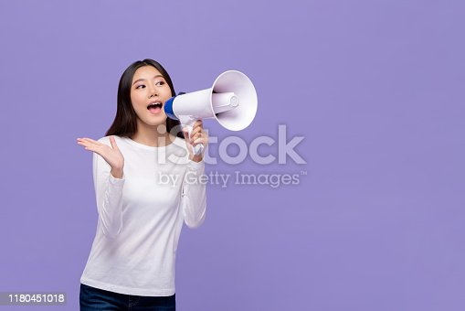 istock Asian woman announcing on magaphone 1180451018