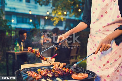 istock Asian woman are cooking for a group of friends to eat barbecue 855325498