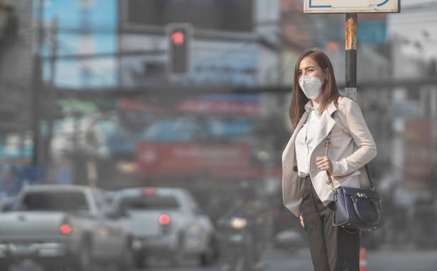 asian woman are going to work.she wears n95 mask.prevent pm2.5 dust - virus stock pictures, royalty-free photos & images