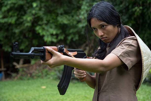Asian woman armed Asian woman armed viet cong stock pictures, royalty-free photos & images