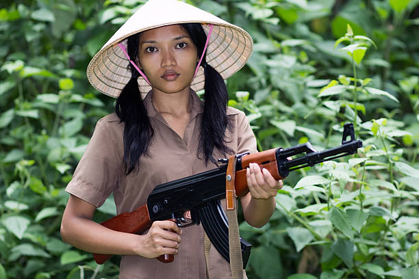 Asian woman armed Asian woman armed in nature viet cong stock pictures, royalty-free photos & images