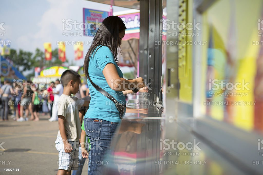Asian woman at concession stand royalty-free stock photo