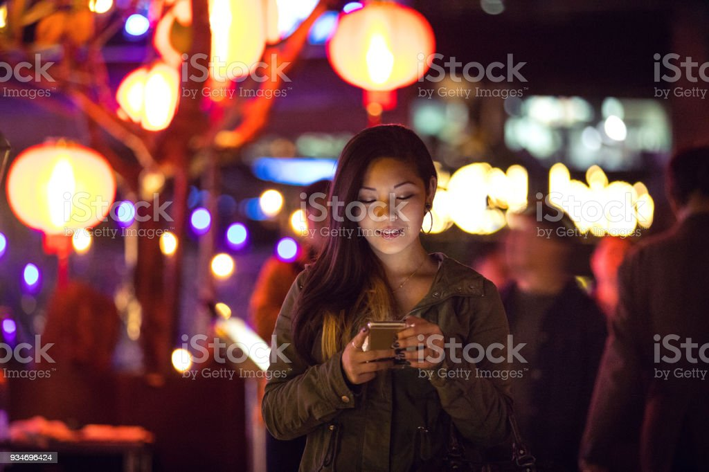 Asian woman at night in downtown Taipei - Taiwan stock photo