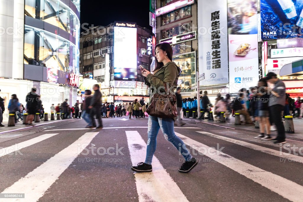 Asian woman at night in Ximen District downtown Taipei - Taiwan stock photo